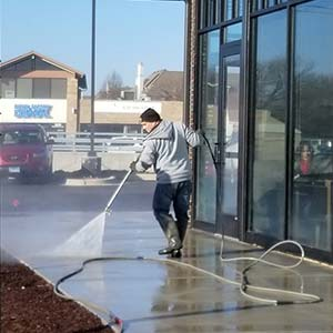 Photo of Powerhouse Pete cleaning concrete for a commercial storefront