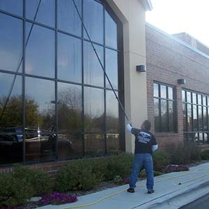 Photo of Powerhouse Pete performing commercial window cleaning