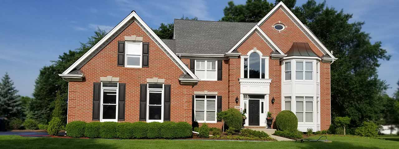 Brick home after professional window cleaning and power washing by Powerhouse