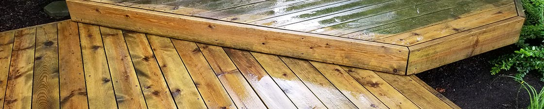 Photo of a deck before and after soft washing cleaning and restoration