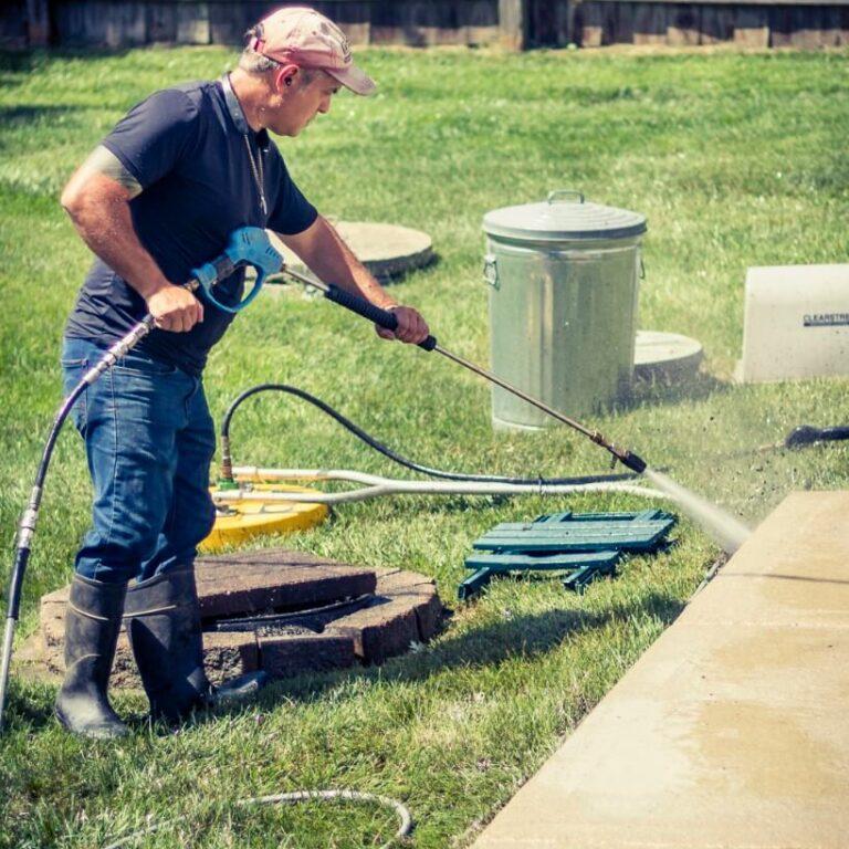 Photo of Powerhouse Pete power washing a concrete sidewalk